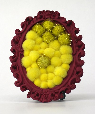 sculpture found oval picture frames painted red violet with shiny yellow pom poms by Holly Campbell