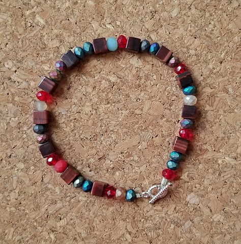 bracelet made with red tiger-eye Czech glass beads with silver-plated toggle clasp by Holly Campbell