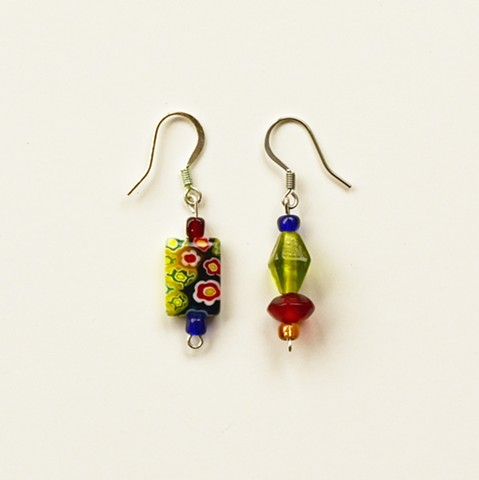 earrings made with asymmetrical glass beads in colbalt, red, green and yellow glass beads with stainless steel ear hooks
