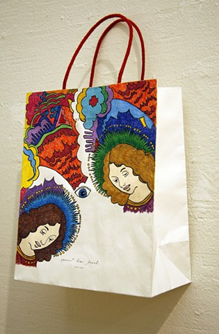 color pencil drawing on an anthropologie shopping bag of two saints eye by Holly Campbell
