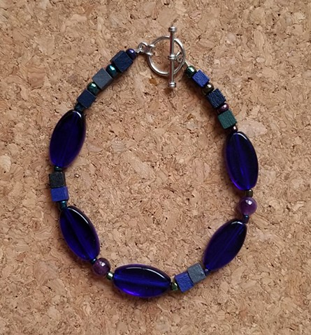 beaded bracelet in cobalt blue amethyst blue violet wood beads seed beaded silver metal toggle by Holly Campbell