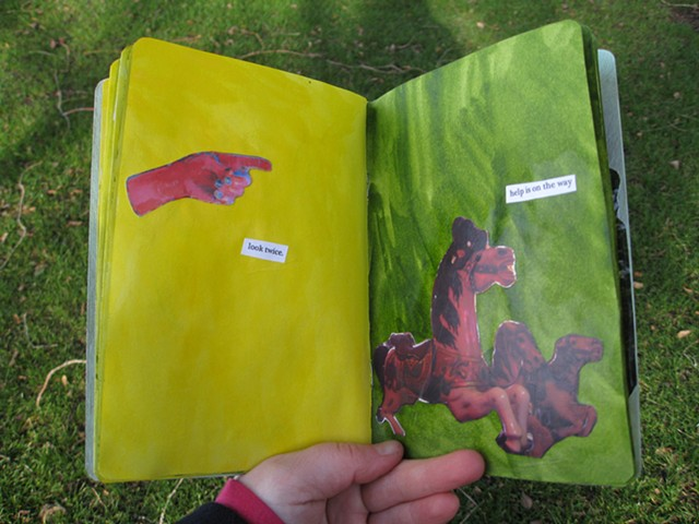2012 sketchbook procect red sculptured hand points the way carousel horses too by Holly Campbell