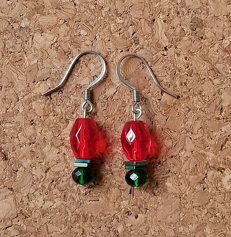 earrigns made with red and green glass beads with hematite beads with stainless steel ear hooks