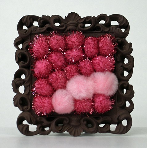 sculpture found picture frame painted brown with shiny pink pom poms by Holly Campbell