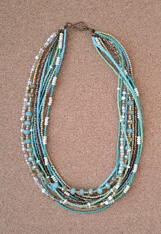 multi-layered necklace, seed and glass beads with genuine brass closure