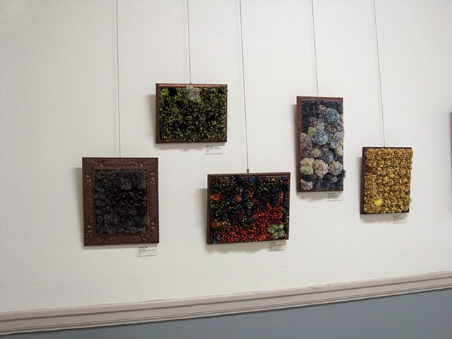 sculpture installation old redmond school house brown glittered picture frames and multicolored yarn pom poms by Holly Campbell