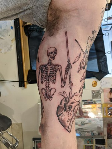 Heart and skeleton tattoo