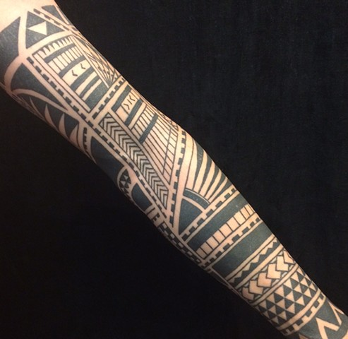 Geometric tribal sleeve tattoo