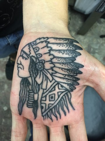 Chief palm tattoo