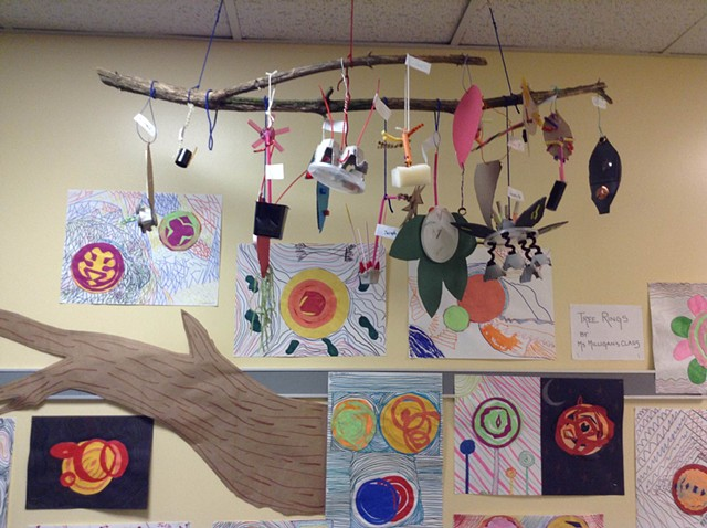 Elementary installation of found object leaves and complementary tree rings and contour drawing