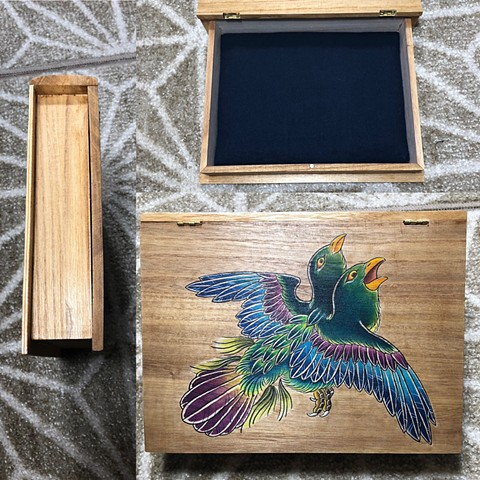 Storage box with two headed bird