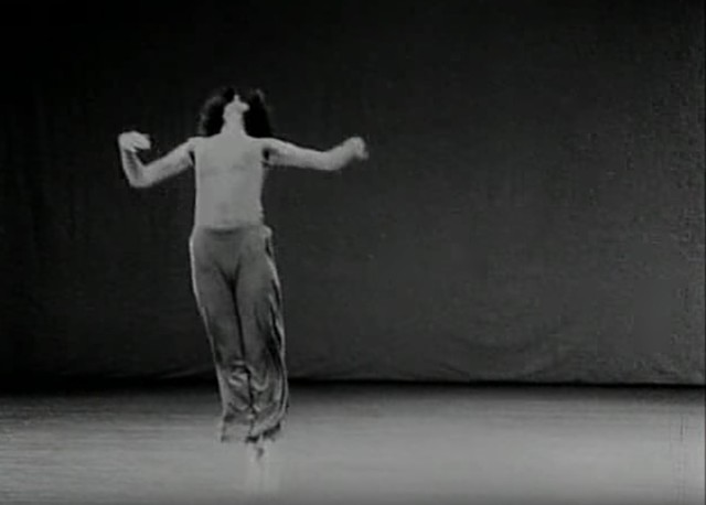 "Still from the 1978 film of Trisha Brown performing ""Watermotor"" by Babette Mangolte"
