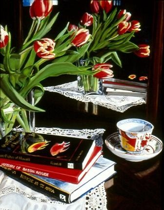Yellow trimmed red tulips bend to table.  Reflection in the mirror shows laced clot, books and Imari cup and saucer.