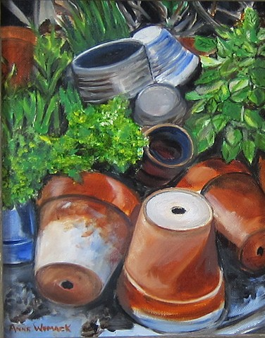 terra cotta clay pots, green folliage, gray and blue pots, scattered or tossed
