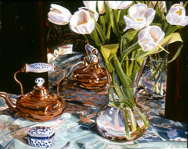 White tulips, green patterned cloth and brass teapot are reflected in a mirror.  White china with blue trim sits on the table.