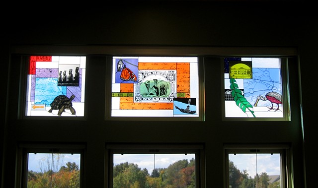 Library windows with camel stamp, Galapagos Tortoise, Roseate Spoonbill, Monarch Butterfly, Easter Island figures, and more