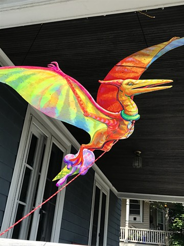 "Terry the Pterodactyl, an Addison to the ""Puppies are furrrrrever!"" Summer 2020 Installation at the corner of Powder House Terrace and Kidder St. Somerville, MA."