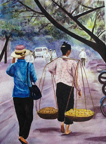 Hanoi, Vietnam, woman carrying baskets, street scene