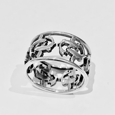 A gorgeous and delicate wide Ring with Pairs of Lucky Koi swimming next to each other in a circle around your finger. Available in Sterling Silver