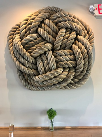 alexbuchanan, alex buchanan art,  Protection by Alex Buchanan is a wall hanging sculpture made of nylon hawser or towing rope.  This nautical or maritime sculpture is 48 inches in diameter.  It is a beautiful example of repurposed materials, protection is