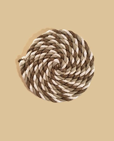 alexbuchanan, alex buchanan art  Weathered Together by Alex Buchanan is a wall hanging sculpture made of nylon, polypropylene, and manila rope.  This nautical or maritime sculpture is 34 inches in diameter.  It is a beautiful example of repurposed materia