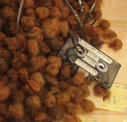 I Don't Know What To Say--detail of audio cassette tape on right side of fiber balls pile