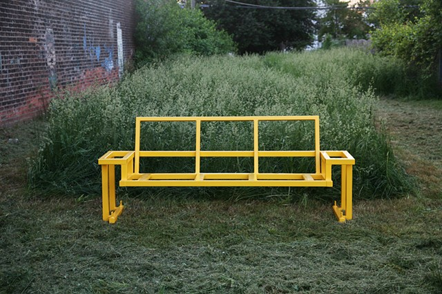 yellow glider frame in grass at studio
