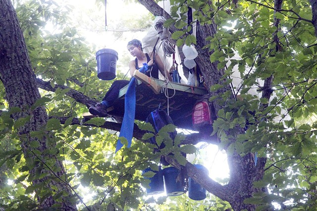 A Water Flag hangs from the tree stand alongside the right of way of the Mountain Valley Pipeline, recently erected and occupied by frontline activist Lauren Bowman. Photo credit: Heather Rousseau for the Roanoke Times