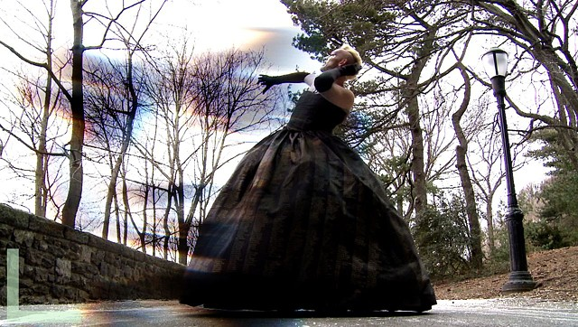 Acid Betting donning Patina du Prey's AIDS Memorial Dress in Neurobotic music video