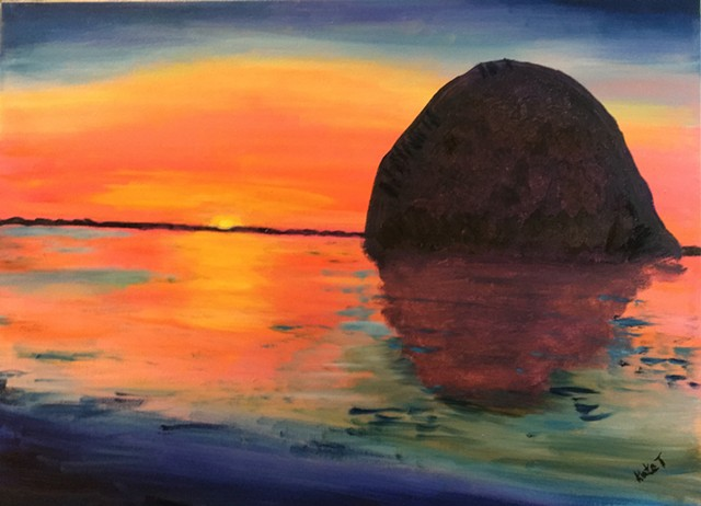 sunset at Morro Bay, CA with the distinctive hug boulder in the bay