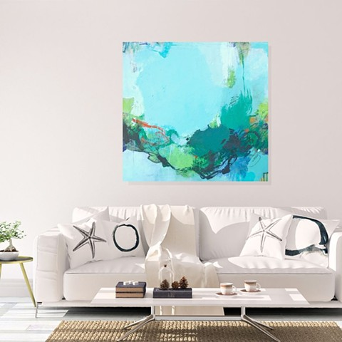 Turquoise and soft blue acrylic and mixed media abstract art piece on canvas in a beachy living room