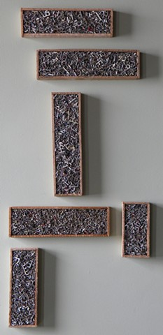 Fordalite pieces in salvaged wood frames mixed media sculptures