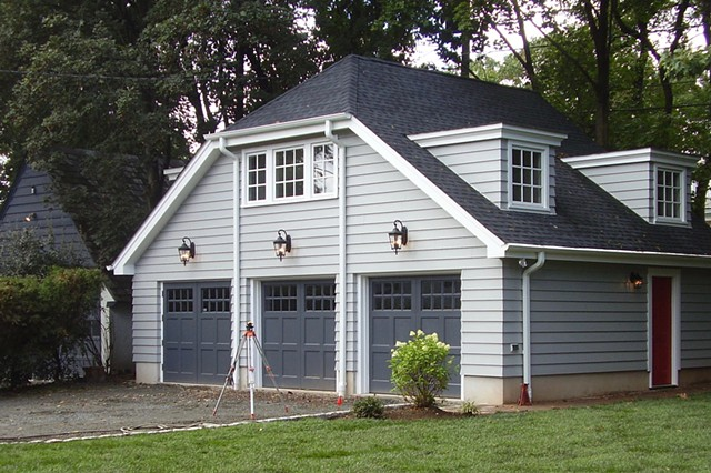 Wright Robinson Architects. Historic District. Painted wood siding. Custom Garage Doors. Jerkinhead roof.