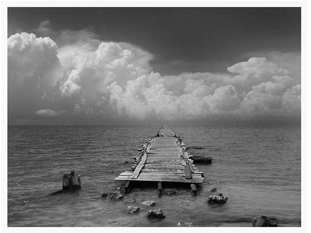 Cuba photograph B&W of bridge about emigration sea clouds borders islands isolation by Aramis Justiz