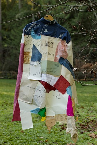 This piece is a collection of love notes and handwritten conversations, transcribed onto a patchwork cloak of paper and fabric.