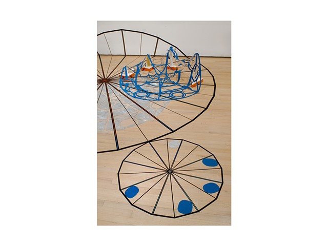 Starwheel Launchpad is a Site Specific Installation by Dianna Frid  Variable dimensions Large circle measures 144 inches in diameter  Tape, cloth, plastic, foil, adhesives, thread, ink, cardboard, metal and plaster  Installed at the Drawing Center, New Y