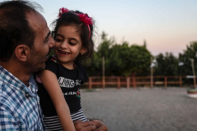 Hala and her father watch the sunset in the Anatolian countryside.  In order to leave the city of Gaziantep, Abu Mahmoud must apply for permission from the Turkish government or risk immediate deportation to Syria.