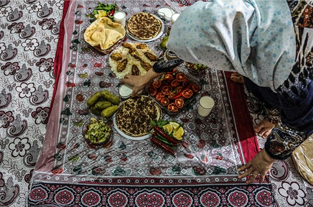 Baheya serves a traditional Syrian dinner in her home.