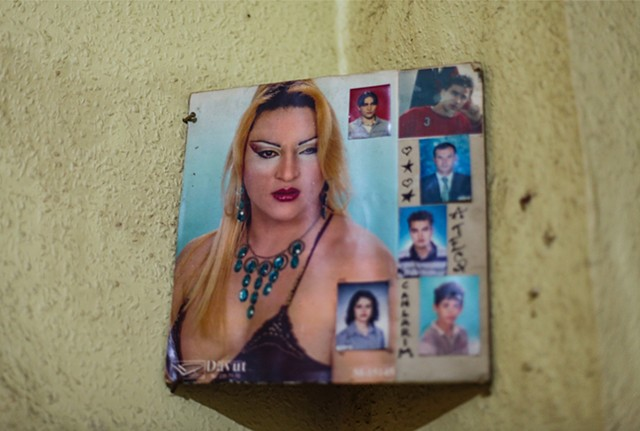 "Angel's glamour shots, of which she's very proud, hang in harmony with some photos of her past school days and others of family members from home in Russia. ""This is who I've always been,"" she says of her new appearance. ""My family can't accept that."""