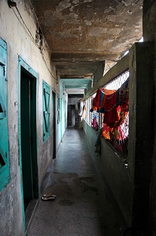 The hallways of the Rathkhola Brothel in Faridpur, Bangladesh showcase drying clothes and, more typically, garbage.