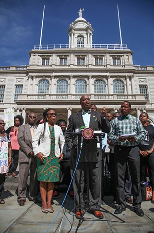 NAACP co-op City Branch President Jerome Rice, joined by Councilwoman Laurie Cumbo and Councilman Andy King, speaks at a press conference at City Hall concerning tennis star James Blake's wrongful arrest on September 16, 2015.