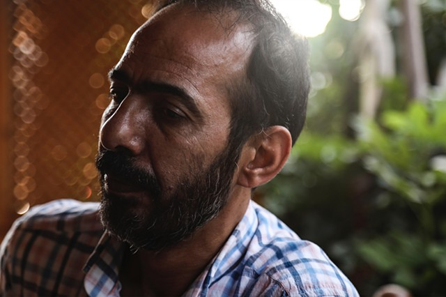 "Abu Mahmoud Gul, Hala's father, sits in a Syrian cafe near his home and anguishes over his past and the horrific state of his beloved country. ""I'm not a criminal. I just want freedom. Everyone wants freedom."""