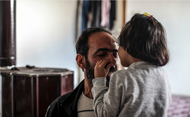 "Hala kisses her father's face and says ""I love you, I love you, I love you!"" in Arabic.  Although this is the family's sole language, she has begun to learn both Turkish and English and  regularly helps them with translation."