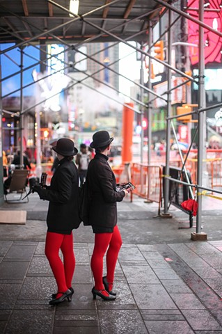 Even with increased security in New York following the terrorism attacks in Paris just two days prior, tourism remains normal in Times Square on November 15, 2015.