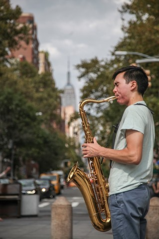 David Yee, a musician new to the city, plays his saxophone in Washington Square Park on September 13, 2015.