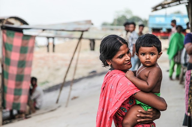 A sex worker who lives with her son in the C & B Ghat sex slum in Faridpur, Bangladesh. Many of the children born in brothels are raised within the community under the care of their mothers and other madams.