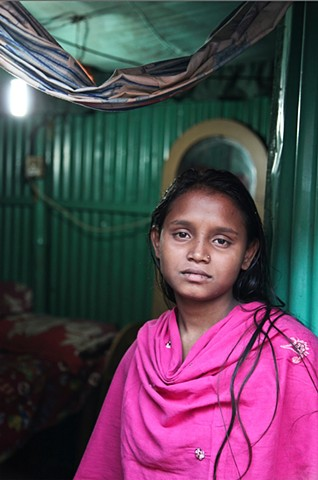 A 14 year old prostitute at the C&B Ghat sex slum in Faridpur, Bangladesh. Young sex workers are given injected steroids like Oradexon, a drug usually given to cattle, to make them look older and more curvaceous. Long term use is said to be fatal.