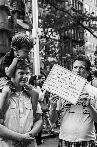 A couple protests with their son at a rally in support of the victims of the Orlando nightclub shootings at The Stonewall Inn in New York on June 12, 2016.