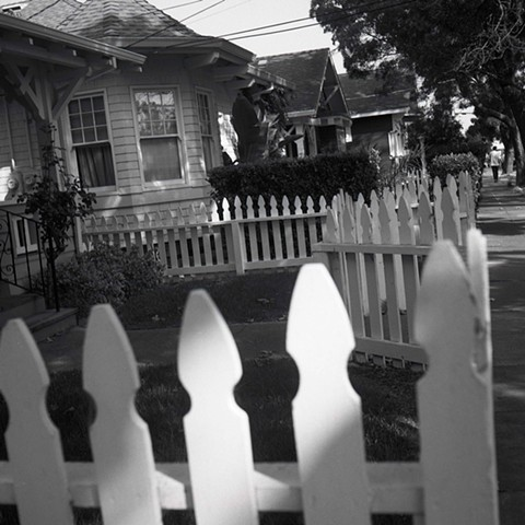 houses with white fences