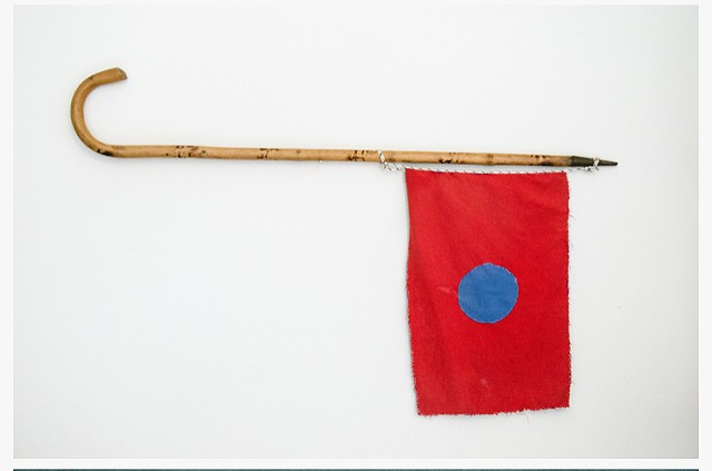 """The Flag of Something Within Something Else"", Pierre Coric knitted flag, walking stick 2018 - 2019"